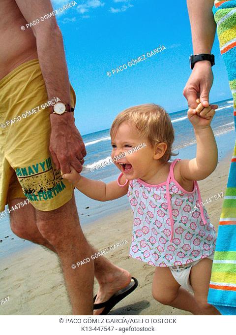 Girl laughing on beach, Maspalomas. Gran Canaria, Canary Islands, Spain