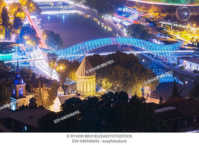 Tbilisi, Georgia - October 21, 2016: Evening Night Scenic Aerial View Of Bridge Of Peace And Tbilisi Sioni Cathedral. Cathedral Of Saint Mary Of Zion