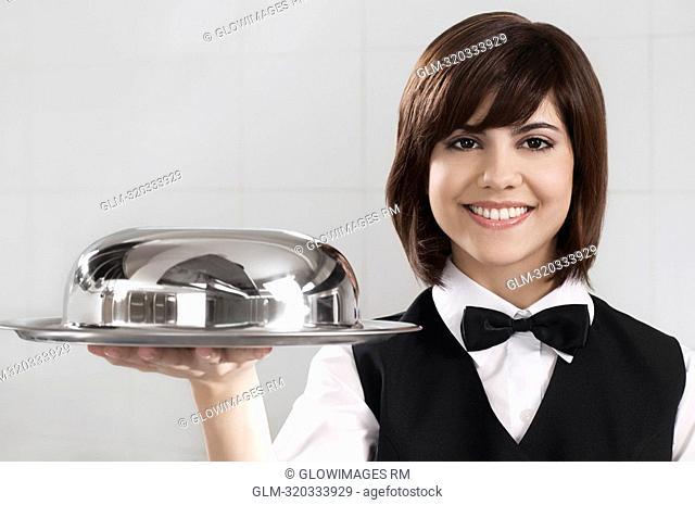 Waitress holding a domed tray