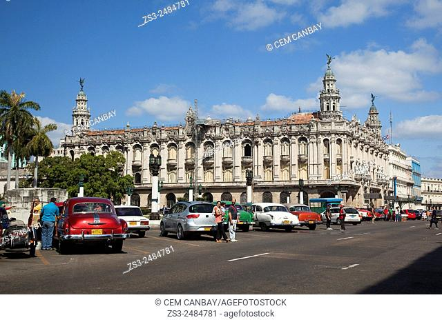 Vintage American cars in front of the Grand Theater building in Central Havana, Cuba, West Indies, Central America