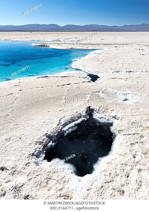 Ojos del Salar, groundwater ponds and surface of the Salar predominantly natriumchloride. Landscape on the salt flats Salar Salinas Grandes in the Altiplano