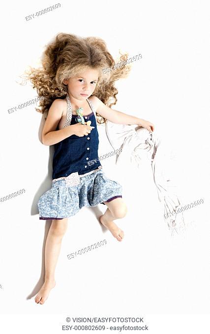 caucasian little girl full length sullen holding blanket isolated studio on white background