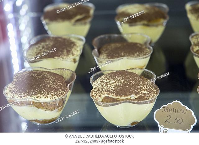 . Display of delicious pastries of tiramisu in Italian pastry shop