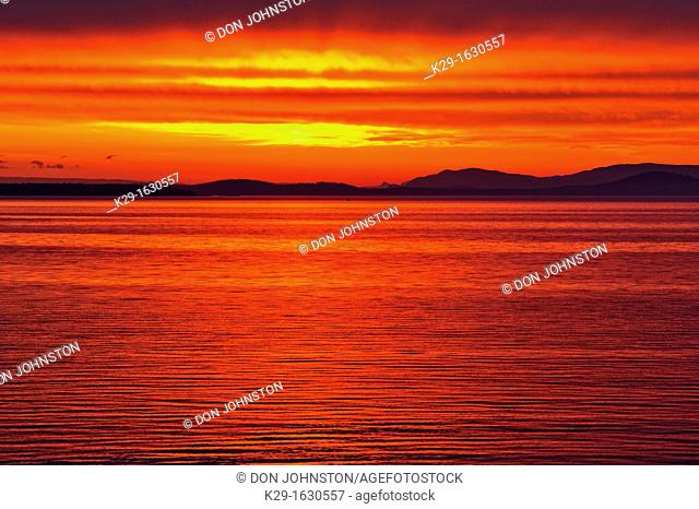 Dawn skies over Haro Strait and the San Juan Islands, Victoria Cordova Bay, BC, Canada