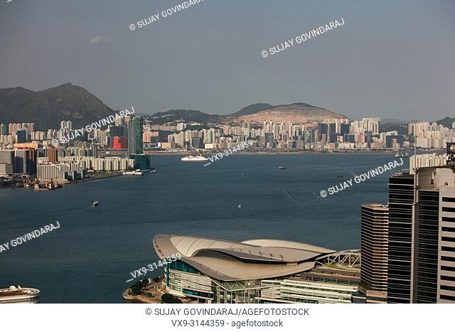 Hong Kong, China - September 25, 2009: Wide view high rise towers, modern buildings and vessels on the sea in Hong Kong