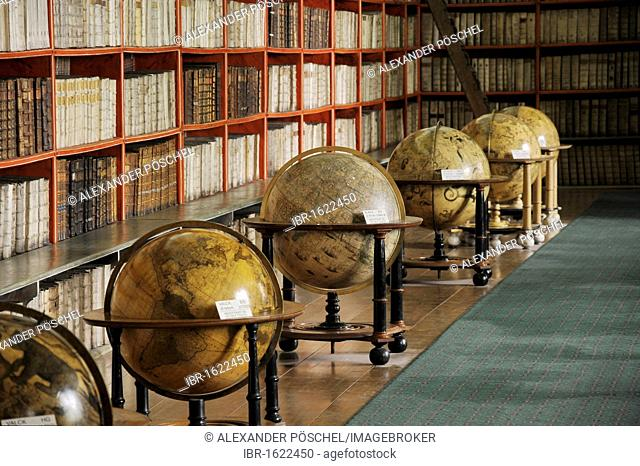Globes and very old books, library, hall of theology, Strahov Monastery, Hradcany, Castle District, Prague, Czech Republic, Europe