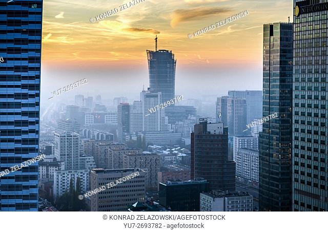 Sunset over Warsaw, Poland. Aerial view from Palace of Culture and Science with Warsaw Spire building site in center