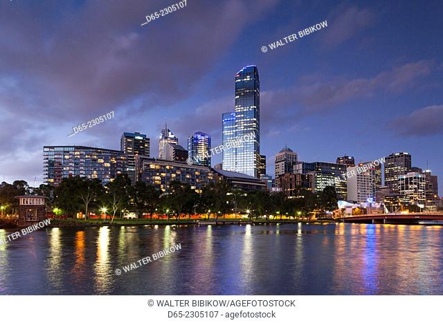 Australia, Victoria, VIC, Melbourne, skyline with Rialto Towers, along Yarra River, dusk