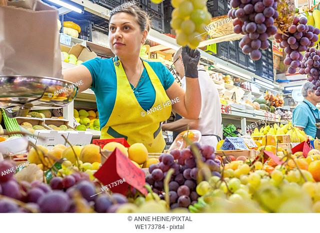 Saleslady at fruit stand, Cagliari, Sardinia, Italy