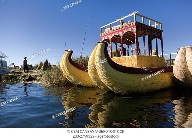 Indigenous people on the totora reed boat, Uros Islands, Lake Titicaca, Puno Region, Peru, South America