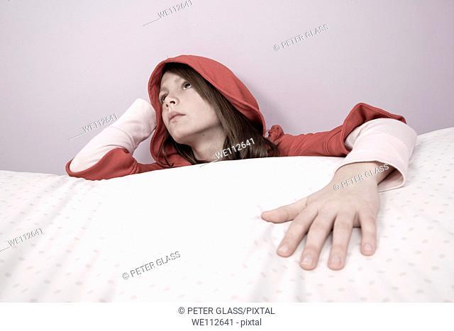 Preteen girl wearing a red hood
