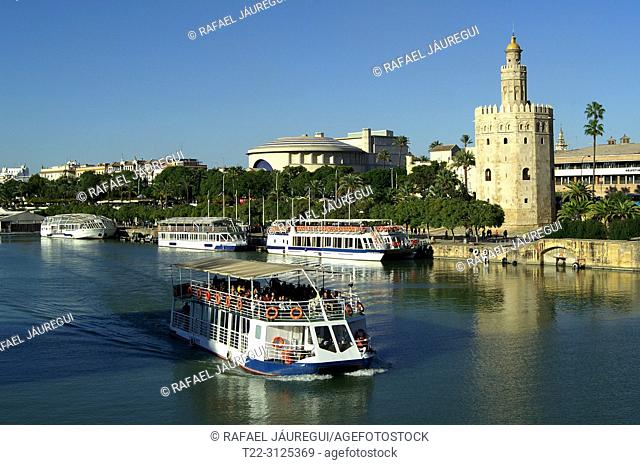 Seville (Spain). Tourist boat sailing on the Guadalquivir river in the city of Seville