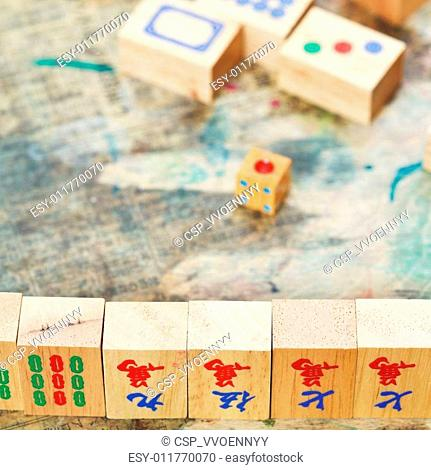 mahjong wood tiles close up and playing field