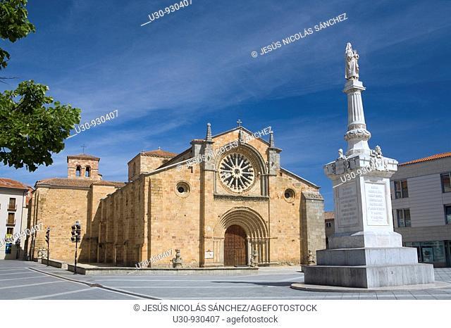 San Pedro church, in romanesque style with a rosette Cistercian, and the Santa Teresa de Jesús statue, in the city of Avila  World Heritage City  Castilla y...
