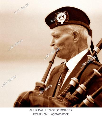 Pipe musician at Loch Ness. Scotland. Great Britain. UK