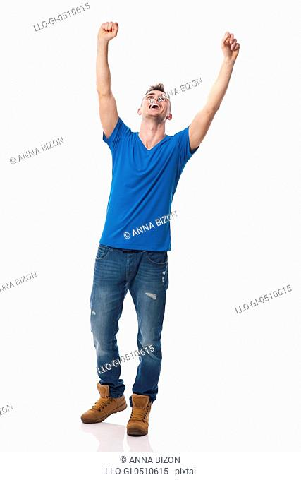 Young happy man celebrating success. Debica, Poland