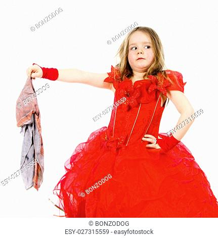Young cinderella dressed in red preparing to mop the floor by dirty cloth. Contrast things concept