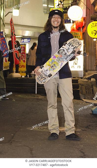 Asian male model poses for pictures in the street