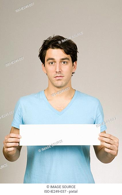 Man with a blank sign