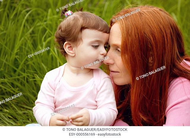 beautiful mother and baby little girl outdoor park garden grass playing