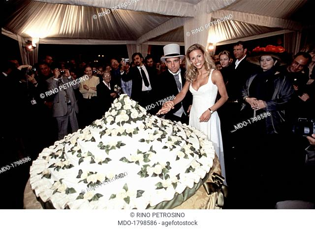 Cutting of the cake at the marriage between Eros Ramazzotti and Michelle Hunziker, under a large gazebo set in the courtyard of the Odescalchi castle; at the...