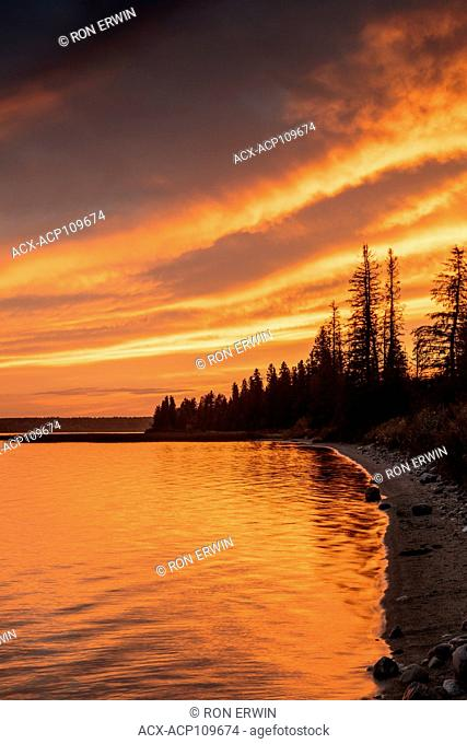 Sunset over Clear Lake in Riding Mountain National Park, Manitoba, Canada
