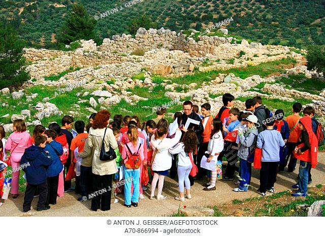 Schoolchildren with teachers visiting the archaeological site of Mycenae in Greece