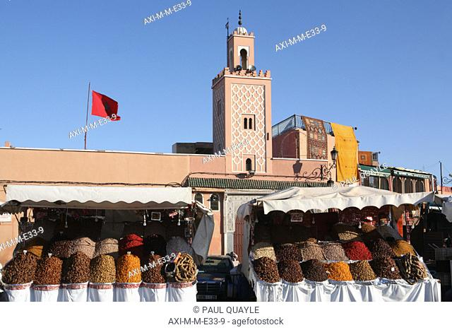 Fruit and nuts for sale at this street stall on Djamaa El Fna,the main square in Marrakesh with mosque in the background