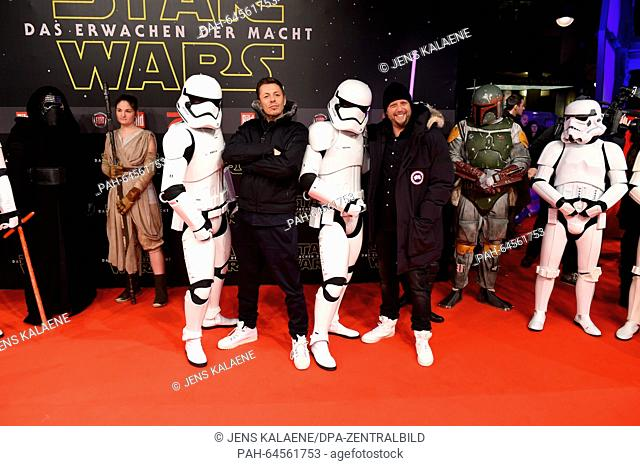 Musicians Smudo (front R) and Michi Beck (front 2-L) of the German hip hop group 'Die Fantastischen Vier' pose with people dressed as stormtroopers on the red...
