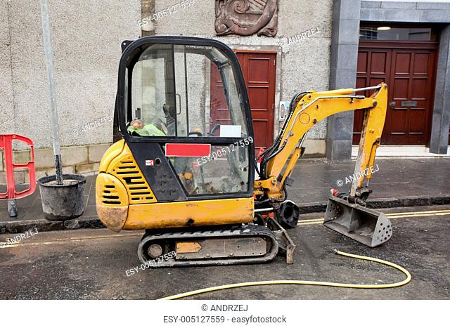 digger on a street
