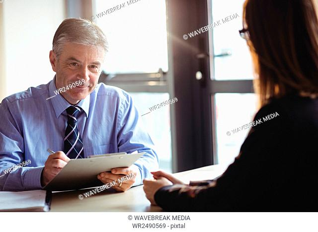 Businessman into discussion with colleague