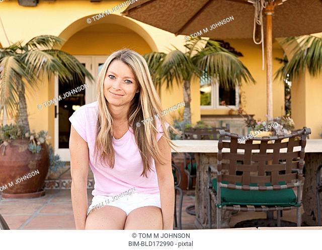 Caucasian woman sitting at patio