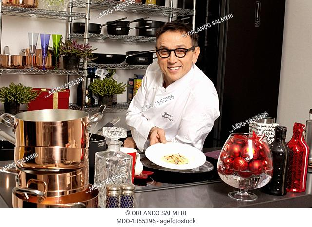 Italian chef awarded with many Michelin stars and judge at the show broadcasted by SkyUno 'Masterchef Italia' Bruno Barbieri leaning on a counter and showing...