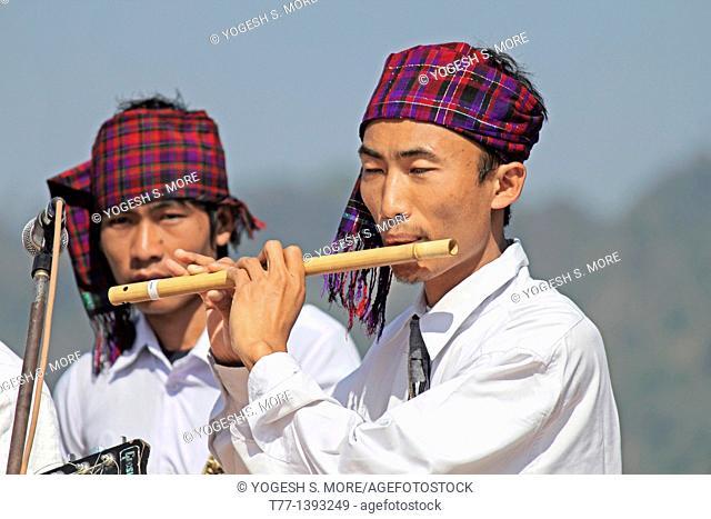 Singpho Man Playing Flute at Namdapha Eco Cultural Festival, Miao, Arunachal Pradesh, India