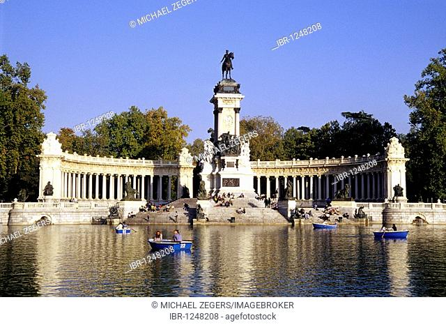 Colonnade and equestrian statue of the monument to Alfonso XII, Glorieta de la Sardana on Estanque, rowboats on the lake in the park, Parque del Retiro, Madrid