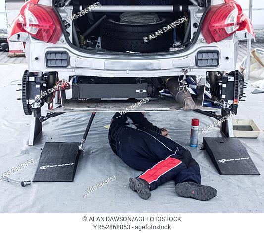 Mechanic under rally car at Islas Canaria rally in Las Palmas, Gran Canaria, Canary Islands, Spain