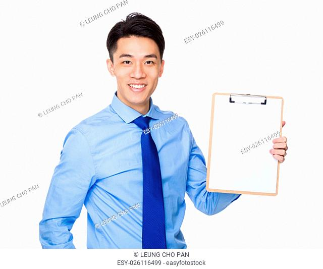 Businessman showing blank page of clipboard