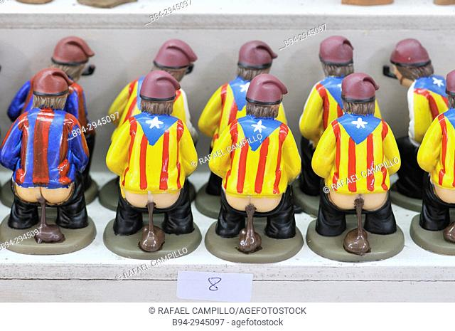'Caganers', particular feature of modern nativity scenes at Santa Llucia Christmas fair, Estelada T-shirt design and Football club Barcelona T-shirt design