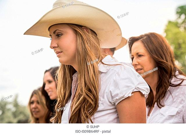 Head and shoulders shot of young women and mature couple strolling on ranch, Bridger, Montana, USA