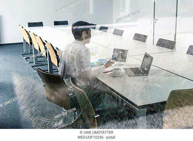 Businesswoman having a video conference in conference room
