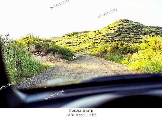 Sandy road viewed through car windshield