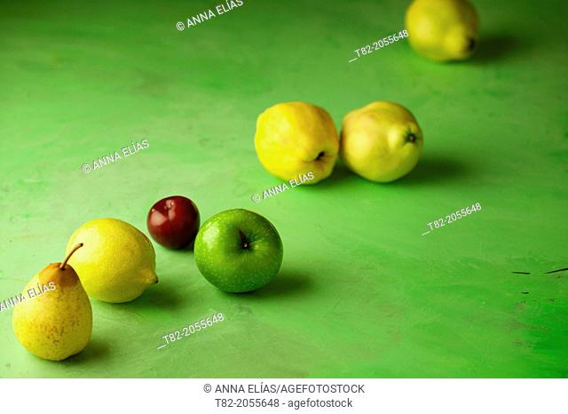 fruit yellow, green and red diagonal green background