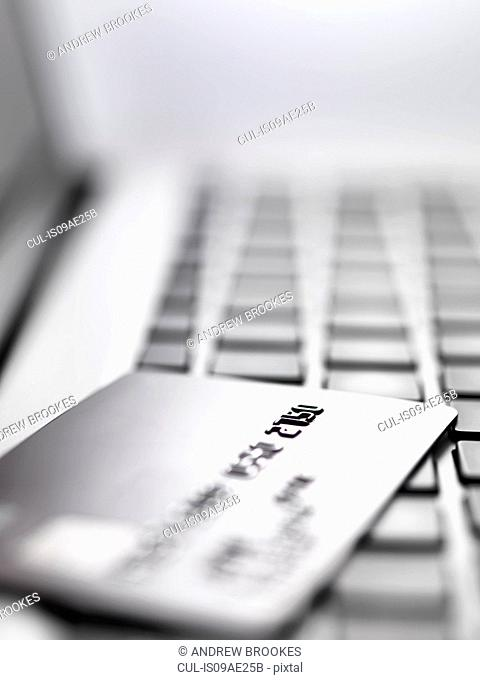 Credit card on laptop to illustrate internet shopping and internet fraud