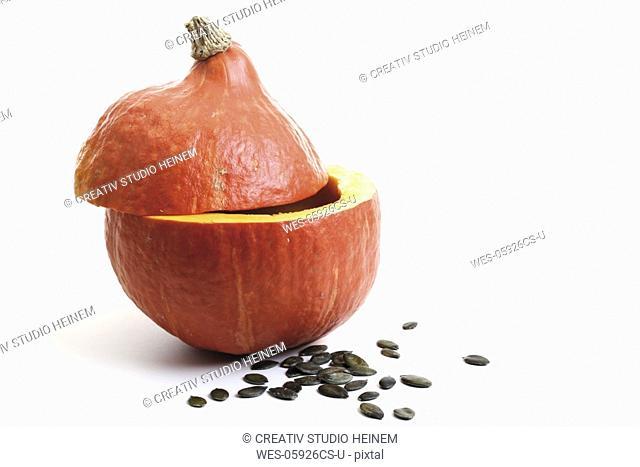 Halved pumpkin with pumpkin seeds