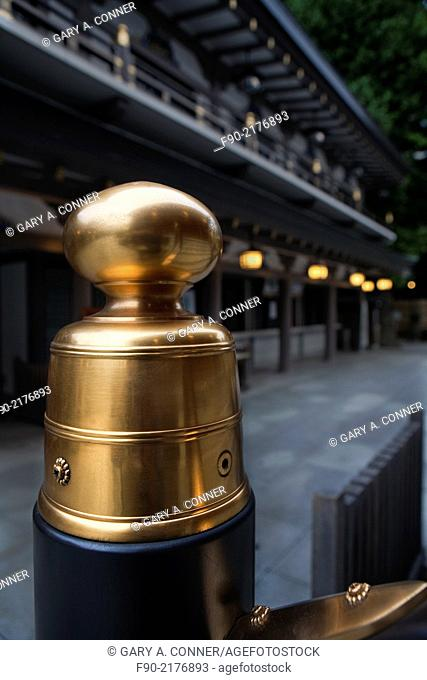 Brass post cap at Yushima Shrine in the evening, Tokyo, Japan