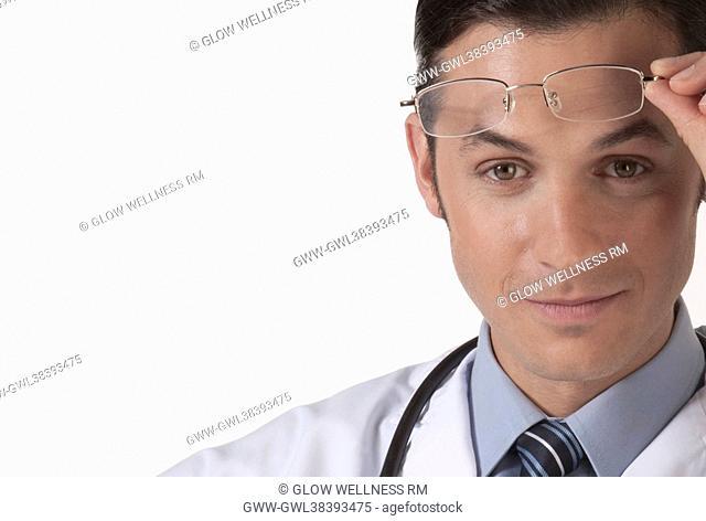 Portrait of a doctor holding eyeglasses