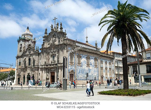 Porto, Portugal, Europe - People on a public square in front of the Carmo and Carmelitas churches