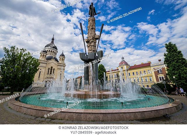 Avram Iancu statue and fountain and Romanian Orthodox Cathedral of Dormition of the Theotokos on Avram Iancu Square in Cluj Napoca city in Romania