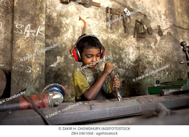 DHAKA, BANGLADESH - 16th June :Child worker working at shipyard near Dhaka in 16th June 2015. . Child labour is not a new issue in Bangladesh