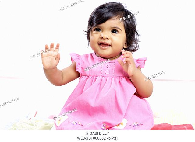 Portrait of smiling baby girl wearing pink dress
